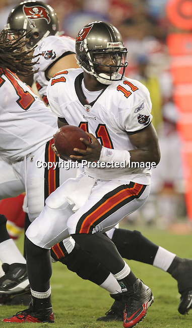 Tampa Bay Buccaneer's quarterback Josh Johnson prepares to handoff in the game against the Kansas City Chiefs. The Buccaneers defeated the Chiefs  20-15 during an NFL preseason game Saturday, Aug. 21, 2010 in Tampa,Fla. (AP Photo/Margaret Bowles).