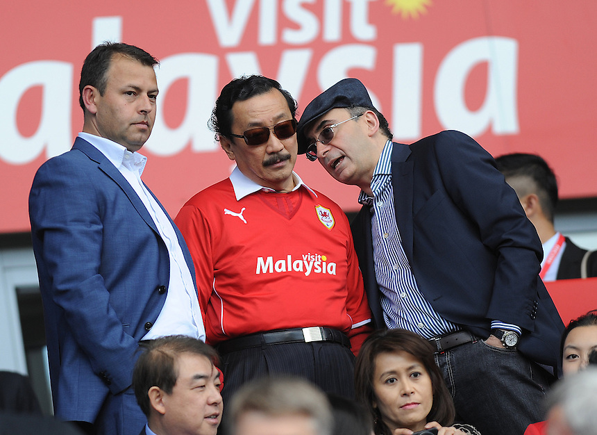 Cardiff City owner Vincent Tan talks prior to kick off<br /> <br /> Photographer Ashley Crowden/CameraSport<br /> <br /> Football - Barclays Premiership - Cardiff City v Chelsea - Sunday 11th May 2014 - Cardifff City Stadium - Cardiff<br /> <br /> &copy; CameraSport - 43 Linden Ave. Countesthorpe. Leicester. England. LE8 5PG - Tel: +44 (0) 116 277 4147 - admin@camerasport.com - www.camerasport.com