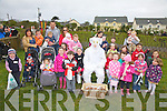 E.B. came out to play at Cracow Park on Valentia Island on Easter Sunday, seen here taking a break with some of the children who came out to look for the hidden eggs.