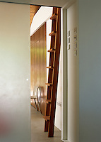 An opaque sliding glass door opens into the bedroom area