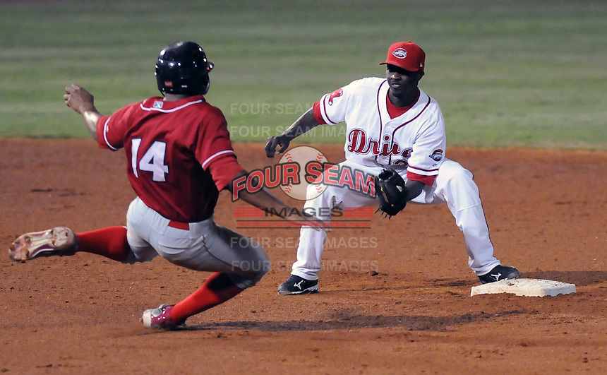 Shortstop Vladimir Frias (29) of the Greenville Drive waits to make the tag on Jonathan Singleton (14) in Game 2 of the South Atlantic League Championship Series against the Lakewood BlueClaws on Sept. 14, 2010, at Fluor Field at the West End in Greenville, S.C. Photo by: Tom Priddy/Four Seam Images