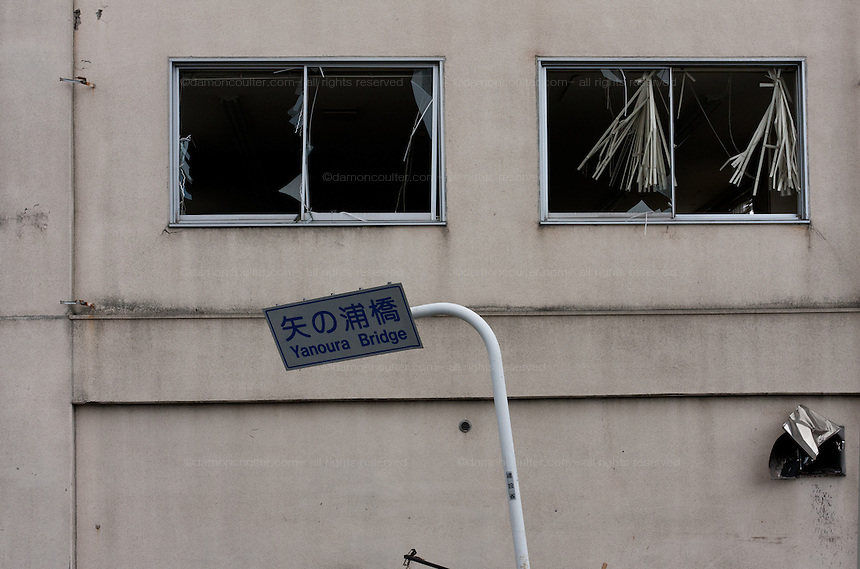 Broken windows in a building affected by the tsunami that struck the north east coast of Japan after the earthquake on March 11th. Kamaishi, Iwate, Japan. March 17th 2011