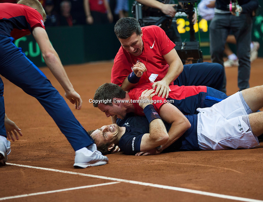 Gent, Belgium, November 29, 2015, Davis Cup Final, Belgium-Great Britain, day three, Andy Murray (GBR) goes down on the clay after defeating David Goffin and scoring the winning point for Great Britain 3-1, captain Leon Smith embraces him, Great Britain wins the Davis Cup 2015.<br /> Photo: Tennisimages/Henk Koster