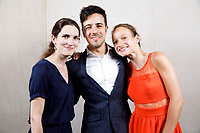 Contestants Klara Woskowiak of Poland, Valerio Lisci of Italy and Emma Thomazeau of France pose at a photo booth during the opening reception and dinner of the 11th USA International Harp Competition at Indiana University in Bloomington, Indiana on Wednesday, July 3, 2019. (Photo by James Brosher)