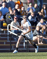 Boston College midfielder Kara Magley (11) brings the ball forward.