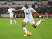 Andre Ayew of Swansea crosses the ball during the Barclays Premier League match between Swansea City and Leicester City at the Liberty Stadium, Swansea on December 05 2015