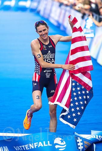 24 AUG 2013 - STOCKHOLM, SWE - Gwen Jorgensen (USA) of the USA celebrates winning the women's ITU 2013 World Triathlon Series round in Gamla Stan, Stockholm, Sweden (PHOTO COPYRIGHT © 2013 NIGEL FARROW, ALL RIGHTS RESERVED)
