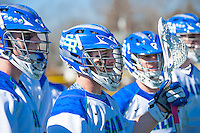 Doug Huber, ''18, left, and Ross Burr,'16, center, encourage teammates from the sidelines as the Seahawks battle Endicott in Men's Lacrosse game action at Gaudet Field in Middletown.