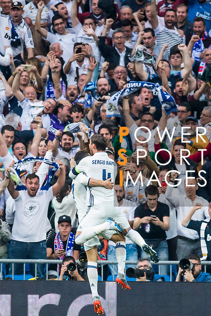 Cristiano Ronaldo of Real Madrid celebrates scoring with teammate Sergio Ramos during their 2016-17 UEFA Champions League Semifinals 1st leg match between Real Madrid and Atletico de Madrid at the Estadio Santiago Bernabeu on 02 May 2017 in Madrid, Spain. Photo by Diego Gonzalez Souto / Power Sport Images