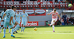 Greg Docherty cracks a shot off the face of the Partick post