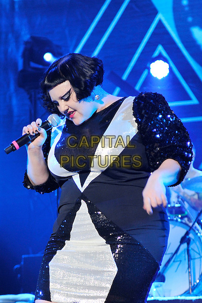 GOSSIP - Beth Ditto.Performing live at Palais Omnisport de Bercy, Paris, France..December 9th, 2010.stage concert live gig performance music half length black grey gray dress sequins sequined shoulder pads singing looking down.CAP/MAR.© Martin Harris/Capital Pictures.