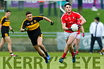 Liam Kearney, East Kerry in action against Michael Burns, Dr Crokes  during the Kerry County Senior Club Football Championship Final match between East Kerry and Dr. Crokes at Austin Stack Park in Tralee, Kerry.