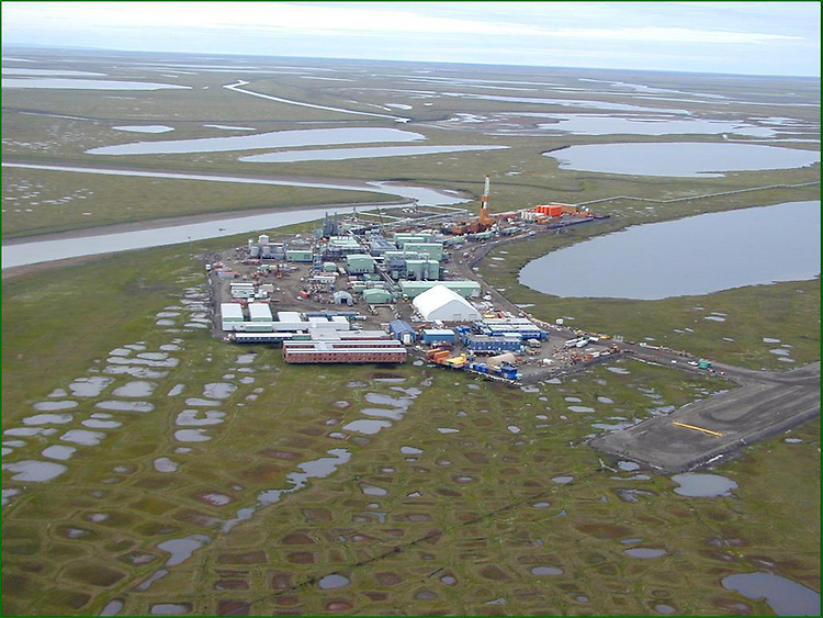 "ANWR1/020602 -- This photo is of the ""Alpine"" oil field facility located on State-owned lands on Alaska's North Slope.  Here's the caption provided in the Interior Department's CD Rom, from which I copied this photo.  ""The Alpine facility is capable of housing 600 workers who are transported to and from the project by fixed-winged aircraft.   During winter, ice roads are used to move modular facilities, large equipment and supplies.  The Alpine field placed gravel fill on less than 100 acres and is anticipated to produce over 420 million barrels of oil""."