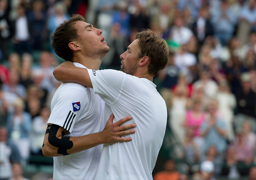 Jerzy Janowicz (POL) celebrates his victory with Lukasz Kubot (POL) after their Gentlemen's Singles Quarter-Finals match today - Jerzy Janowicz (POL) [24] def Lukasz Kubot (POL) 7-5 6-4 6-4 <br /> <br />  (Photo by Stephen White/CameraSport) <br /> <br /> Tennis - Wimbledon Lawn Tennis Championships - Day 9 Tuesday 3rd July 2013 -  All England Lawn Tennis and Croquet Club - Wimbledon - London - England<br /> <br /> &copy; CameraSport - 43 Linden Ave. Countesthorpe. Leicester. England. LE8 5PG - Tel: +44 (0) 116 277 4147 - admin@camerasport.com - www.camerasport.com.