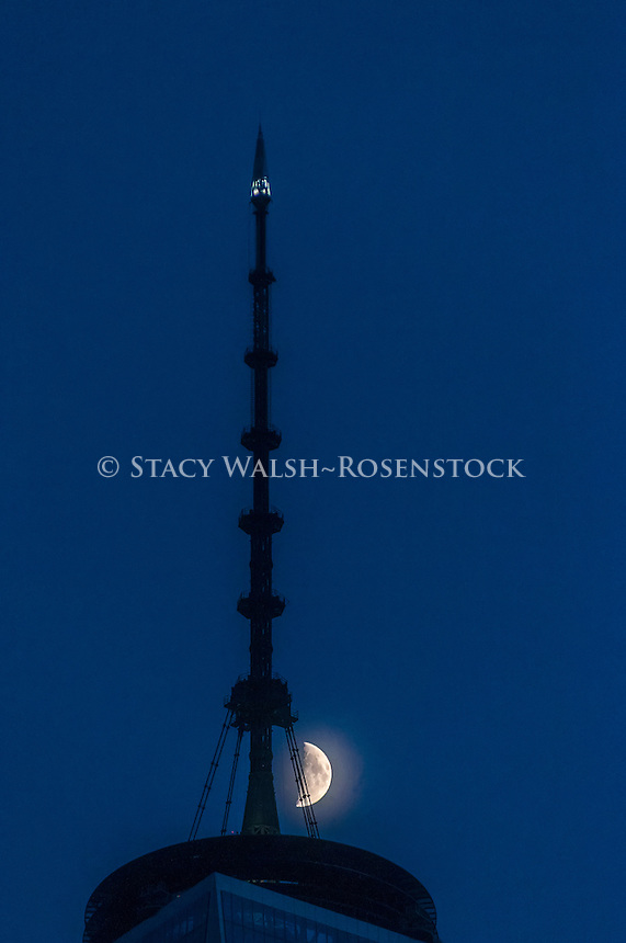 New York, USA 8 September 2016 - The moon passing over One World Trade Center in Lower Manhattan ©Stacy Walsh Rosenstock
