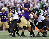 Tuli Letuligasenoa (center) caused problems for the Hawaii offensive line early on. No holding was called on this play.