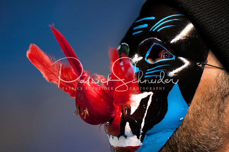 A Carolina Panthers fans displays team pride with a mask featuring a Panther eating a Cardinal during the NFC Divisional Playoff football game at Bank of America Stadium, in Charlotte, NC. Arizona defeated the Carolina Panthers 33-13.