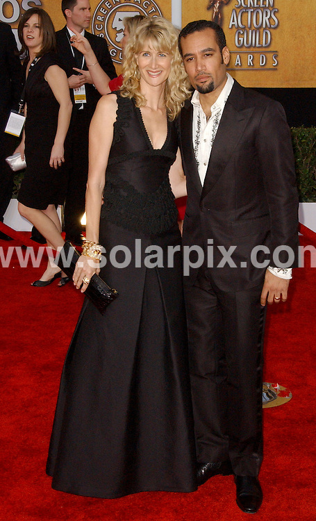 **ALL ROUND PICTURES FROM SOLARPIX.COM**.**SYNDICATION RIGHTS FOR UK, AUSTRALIA, DENMARK, PORTUGAL, S. AFRICA, SPAIN & DUBAI (U.A.E) ONLY**.arrivals for the 15th Annual Screen Actors Guild Awards, held at the The Shrine Auditorium, Los Angeles, California, USA. January 25, 2009..This pic: Laura Dern and Ben Harper..JOB REF: 8318 PHZ (Ortega)   DATE: 25_01_2009.**MUST CREDIT SOLARPIX.COM OR DOUBLE FEE WILL BE CHARGED* *UNDER NO CIRCUMSTANCES IS THIS IMAGE TO BE REPRODUCED FOR ANY ONLINE EDITION WITHOUT PRIOR PERMISSION*