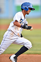Asheville Tourists center fielder Manny Melendez (24) rounds third base during a game against the Rome Braves at McCormick Field on June 12, 2017 in Asheville, North Carolina. The Tourists defeated the Braves 7-0. (Tony Farlow/Four Seam Images)