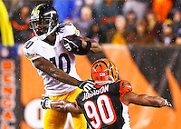 Martavis Bryant #10 of the Pittsburgh Steelers evades a tackle by Michael Johnson #90 of the Cincinnati Bengals after catching a pass during the Wild Card playoff game at Paul Brown Stadium on January 9, 2016 in Cincinnati, Ohio. (Photo by Jared Wickerham/DKPittsburghSports)