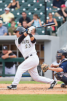 Miguel Gonzalez (23) of the Charlotte Knights follows through on his swing against the Pawtucket Red Sox at BB&T Ballpark on August 8, 2014 in Charlotte, North Carolina.  The Red Sox defeated the Knights  11-8.  (Brian Westerholt/Four Seam Images)