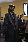 A new Black Panther attends the funeral of housing activist Beauty Turner, 51, a one-time resident of the Robert Taylor Homes who led the Beauty Turner Ghetto Bus Tour and received national recognition in publications such as The Wall Street Journal, at the Greater Harvest Missionary Baptist Church on South State Street in Chicago, Illinois on December 26, 2008.  Turner died of an aneurysm on December 18.