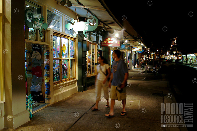 Shoppers head out into the evening to enjoy the many stores,art galleries and restaurants along Front street in historic downtown Lahiana,Maui.