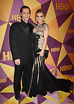 BEVERLY HILLS, CA - JANUARY 07: Actor Clifton Collins Jr. (L) and model/actress Carmen Electra arrive at HBO's Official Golden Globe Awards After Party at Circa 55 Restaurant in the Beverly Hilton Hotel on January 7, 2018 in Los Angeles, California.