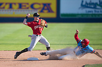Vancouver Canadians second baseman Nick Podkul (6) throws to first base for a double play as Curtis Terry (28) slides into second base during a Northwest League game against the Spokane Indians at Avista Stadium on September 2, 2018 in Spokane, Washington. The Spokane Indians defeated the Vancouver Canadians by a score of 3-1. (Zachary Lucy/Four Seam Images)