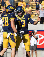California kicker Vincenzo D'Amato celebrates with Jackson Bouza after scoring a field goal during the game at Memorial Stadium in Berkeley, California on October 5th, 2013.  Washington State defeated California, 44-22.