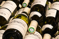 pile of bottles hautes cotes de beaune dom e monnot & f santenay cote de beaune burgundy france