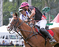 WELLINGTON, FL - APRIL 25:  Polito Pieres of Orchard Hill (dark jersey) and Adolfo Cambiaso of Valiente battle for the ball, as Valiente defeats Orchard Hill 13-12, in OT,  in the US Open Polo Championship Final, to win the U. S. Polo Triple Crown, at the International Polo Club Palm Beach, on April 25, 2017 in Wellington, Florida. (Photo by Liz Lamont/Eclipse Sportswire/Getty Images)