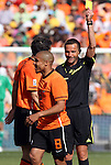 14 JUN 2010:  Referee Stephane Lannoy (FRA) issues a yellow card caution to Nigel de Jong (NED)(8).  The Netherlands National Team defeated the Denmark National Team 2-0 at Soccer City Stadium in Johannesburg, South Africa in a 2010 FIFA World Cup Group E match.