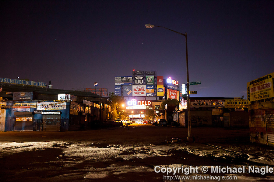QUEENS, NY -- OCTOBER 25, 2013:  Citifield glows beyond the darkened streets of Willets Point on October 25, 2013 in Queens, NY.  PHOTOGRAPH  BY MICHAEL NAGLE FOR THE NEW YORK TIMES