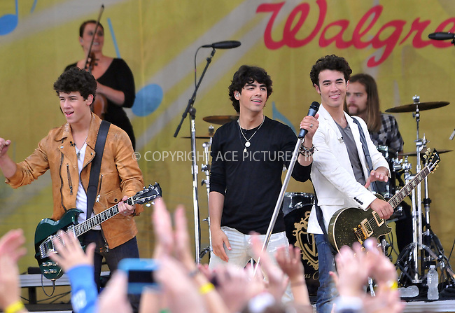 WWW.ACEPIXS.COM . . . . .  ....June 12 2009, New York City....Nick Jonas, Joe Jonas, and Kevin Jonas of The Jonas Brothers perform on ABC's 'Good Morning America in Central Park on June 12, 2009 in New York City.....Please byline: AJ Sokalner - ACEPIXS.COM..... *** ***..Ace Pictures, Inc:  ..tel: (212) 243 8787..e-mail: info@acepixs.com..web: http://www.acepixs.com