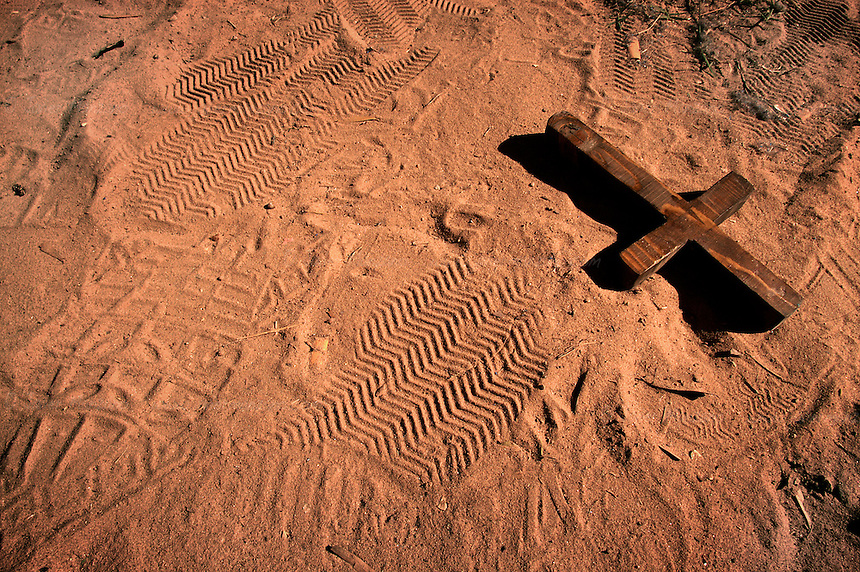 A wooden cross lies on the ground, after an immigrant tossed it on the dusty back patio of ?Casa Moreno? a place that houses illegal immigrants in Summerton, AZ.