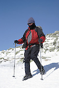 Hiker on the Franconia Ridge Trail (Appalachian Trail) during the winter months in the White Mountains, New Hampshire USA.