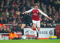 Arsenal's Rob Holding and West Ham's Chicharito during the Carabao Cup QF match between Arsenal and West Ham United at the Emirates Stadium, London, England on 19 December 2017. Photo by Andrew Aleksiejczuk / PRiME Media Images.