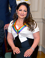 Gloria Estefan, one of he five recipients of the 40th Annual Kennedy Center Honors with his award as he poses for a group photo following a dinner hosted by United States Secretary of State Rex Tillerson in their honor at the US Department of State in Washington, D.C. on Saturday, December 2, 2017. The 2017 honorees are: American dancer and choreographer Carmen de Lavallade; Cuban American singer-songwriter and actress Gloria Estefan; American hip hop artist and entertainment icon LL COOL J; American television writer and producer Norman Lear; and American musician and record producer Lionel Richie. Photo Credit: Ron Sachs/CNP/AdMedia