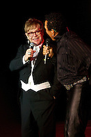 Elton Johna and Smokey Robinson sing a duet at Elton John's White Tie and Tiara Ball