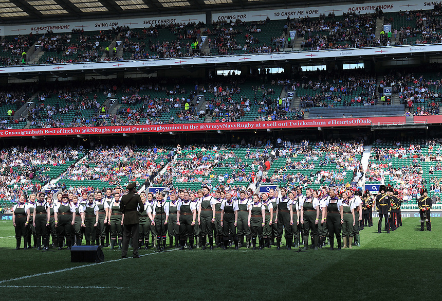 Members of the Military Wives Choir (left) and the Band of the Royal Artillery entertain the crowd before the Army Navy game<br /> <br /> Photographer Ashley Western/CameraSport<br /> <br /> Rugby Union - Babcock Trophy - Army v Navy - Saturday 3rd May 2014 - Twickenham - London<br /> <br /> &copy; CameraSport - 43 Linden Ave. Countesthorpe. Leicester. England. LE8 5PG - Tel: +44 (0) 116 277 4147 - admin@camerasport.com - www.camerasport.com