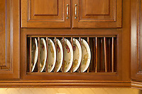 Kitchen cabinets displaying plates.