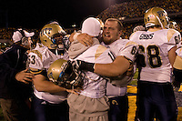 Pitt center Chris Vangas hugs injured quarterback Bill Stull (face not visible) after the Pitt Panthers upset the West Virginia Mountaineers 13-9 on December 01, 2007 in the 100th edition of the Backyard Brawl at Mountaineer Field, Morgantown, West Virginia.