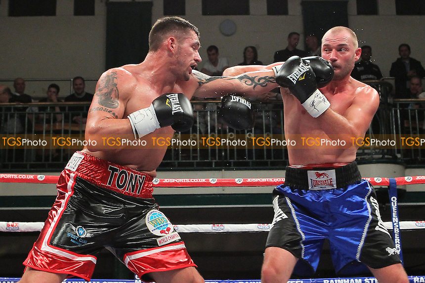 Tony Conquest (black/red shorts) defeats Daniel Ammann in a Cruiserweight Boxing Contest for the Commonwealth Title at York Hall, Bethnal Green, London, promoted by Frank Warren - 22/02/14 - MANDATORY CREDIT: Gavin Ellis/TGSPHOTO - Self billing applies where appropriate - 0845 094 6026 - contact@tgsphoto.co.uk - NO UNPAID USE