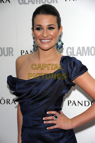 Lea Michele.Women Of The Year 2012 - Glamour Awards, Berkeley Square, London, England..29th May 2012.half length blue off the shoulder dress hand on hip green earrings smiling ring.CAP/PL.©Phil Loftus/Capital Pictures.