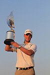 Martin Kaymer holds aloft the winning trophy of the Abu Dhabi HSBC Golf Championship 2011, at the Abu Dhabi golf club, UAE. 22/1/11. His third year in a row to win the event he gets to keep the trophy..Picture Fran Caffrey/www.golffile.ie.