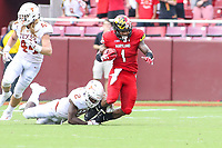 Landover, MD - September 1, 2018: Maryland Terrapins wide receiver DJ Turner (1) gets tackled by Texas Longhorns defensive back Kris Boyd (2) during the game between Texas and Maryland at  FedEx Field in Landover, MD.  (Photo by Elliott Brown/Media Images International)