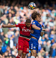 David Luiz of Chelsea & Richarlison of Watford during the Premier League match between Chelsea and Watford at Stamford Bridge, London, England on 21 October 2017. Photo by Andy Rowland.