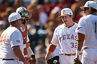 Texas Longhorns starting pitcher Dillon Peters #32 stands on the mound as pitching coach Skip Johnson #44 comes to remove him from the NCAA baseball game against the Oklahoma Sooners on April 6, 2013 at UFCU DischFalk Field in Austin, Texas. The Longhorns defeated the rival Sooners 1-0. (Andrew Woolley/Four Seam Images).