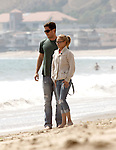 8-19-09  ..Hayden Panettiere walking her dogs down the beach while holding hands with her new boyfriend Harry Morton owner of the Viper room. Hayden was  jumping, skipping & running around laughing & playing. It was really funny watching Hayden playing fetch with a giant Rottweiler doggy. The couple seemed extremely happy & care free as the ocean waves crashed down on the sandy beaches of Malibu california...AbilityFilms@yahoo.com.805-427-3519.www.AbilityFilms.com.